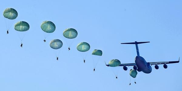 U.S. Army Rangers parachute from a plane