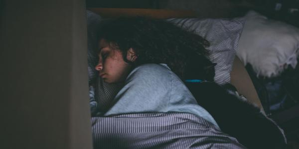 Woman sleeps in dark room