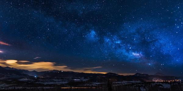 Starry night over mountainscape