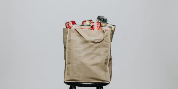 reusable grocery bag filled with canned food