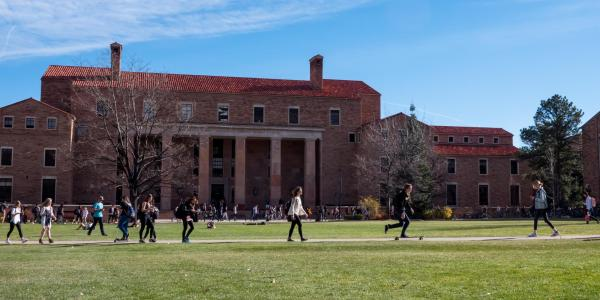 Students walk across Norlin Quad