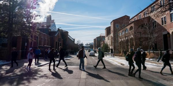 Students walk across campus on a cold day