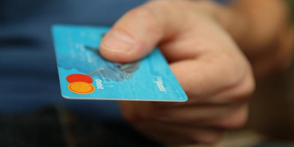 Person pays with debit card
