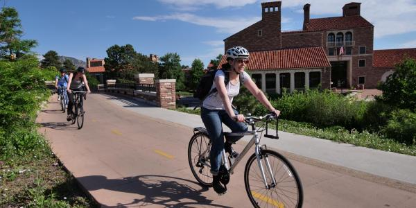 CU employee bikes to work along the creek path