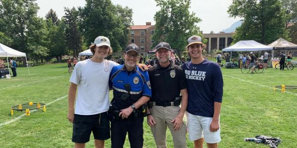 CUPD commanders Tom Matlock and Bill Webb help students register bikes and learn about theft prevention at 2021 CU Bike Fest