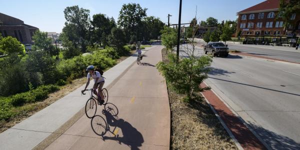 person biking near campus