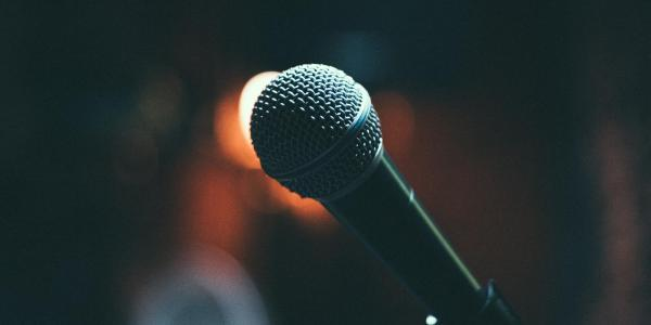 Close-up photo of a microphone on stage