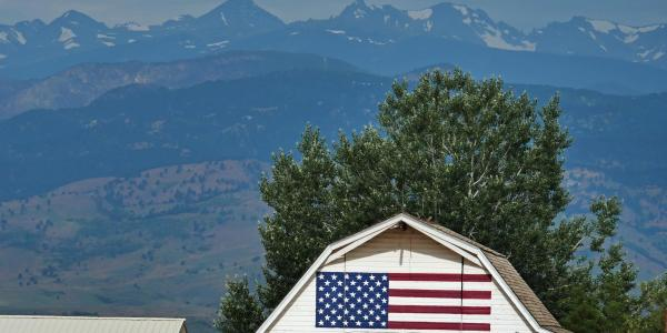 Flag on side of barn