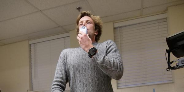 Tom Heinbockel demonstrating using a Power Breathe device
