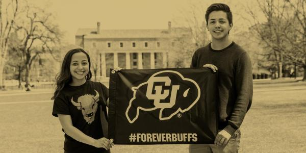 Students holding a Forever Buffs flag in front of Norlin