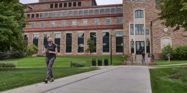 Students walking between class near the CU Law school.