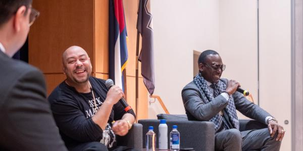 "Yusef Salaam, right, and Raymond Santana, two of the five ""Exonerated Five"" who were wrongly convicted of a brutal attack on a Central Park jogger answered questions during an informal Cultural Events Board talk at the University Memorial Center on March 10. 2020. (Photo by Glenn Asakawa/University of Colorado)"