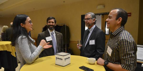 Faculty members mingle at the inaugural Faculty Awards Celebration