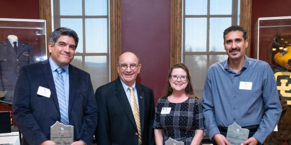Four recipients, pictured with the chancellor, are the recipients of the Employee of the Year Award for 2019