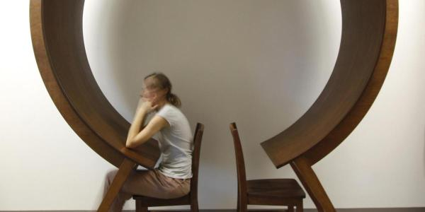 Woman sits unique circle table