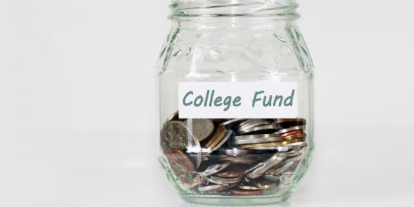"Stock image of a money jar labeled ""College Fund"""