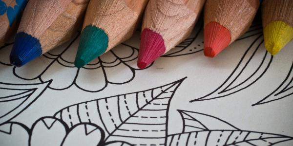 Colored pencils and an adult coloring book