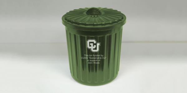 Green mini compost bin on campus