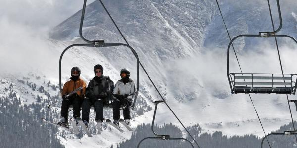 skiers on a ski life
