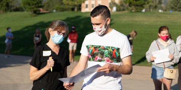 Campus community members wearing masks