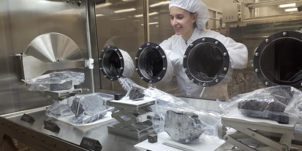 Geologist Carolyn Crow investigating moon rocks at NASA's Johnson Space Center in Houston.