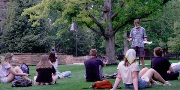 A CU Teach class meets outdoors
