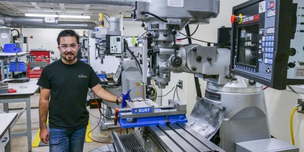 Behruzkhon Rashidov, President and founder of the CU Boulder Racing Team, works in the Idea Forge Machine shop.