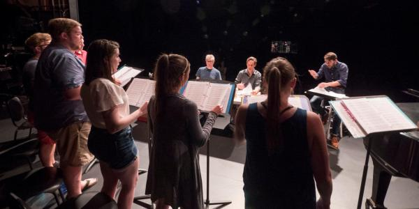 Singers and faculty workshop a new piece in the CU New Opera Workshop