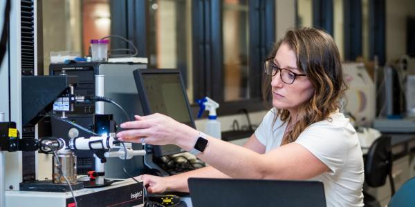 Kristine Fischenich working on lab equipment