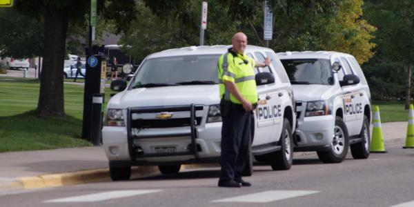CUPD officer directing traffic
