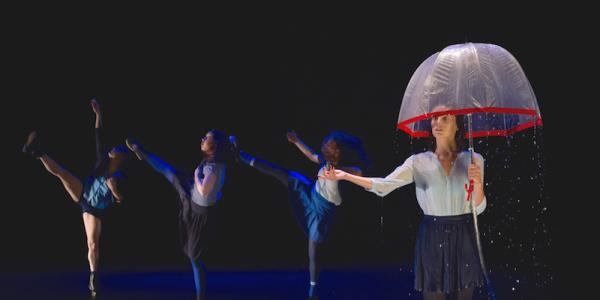 Dance performance, woman under umbrella