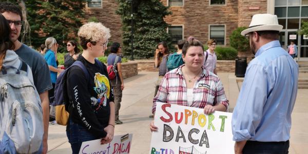 People protesting in favor of keeping DACA