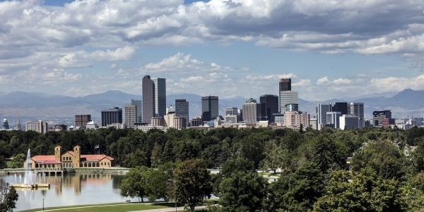 A photo of downtown Denver in front of the Rocky Mountains.