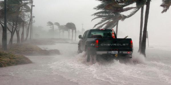 Truck drives on flooded street in Key West, Florida
