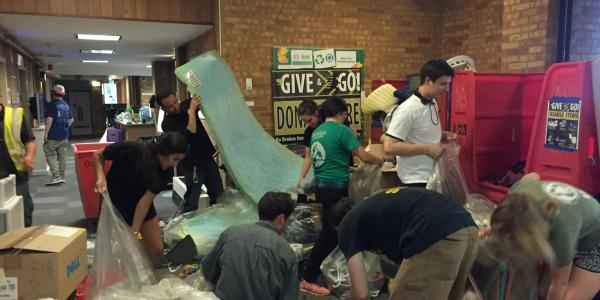 Volunteers work during move-out donation drive