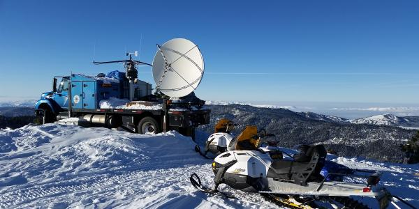 A Doppler radar system sits on the flatbed of a truck.