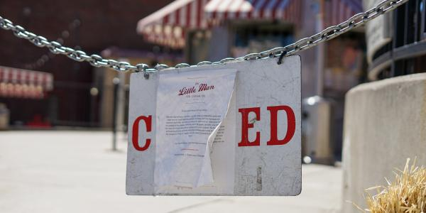 A closed sign in front of Little Man Ice Cream in Denver, CO.