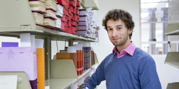 Graduate student Eben Yonnetti with Tibetan text
