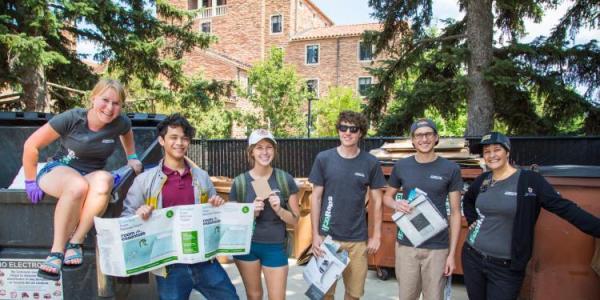 Student volunteers sort recyclables