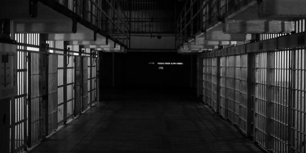 A black and white photo of prison cells
