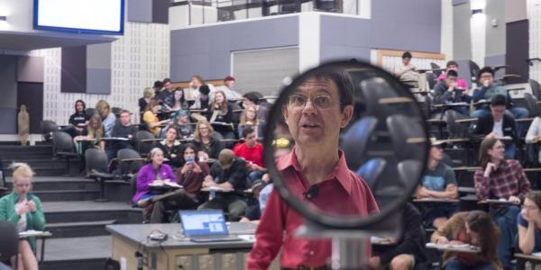 Seen through a magnifying glass, CU Boulder Nobel Laureate and physics professor Eric Cornell teaches a lesson on lenses