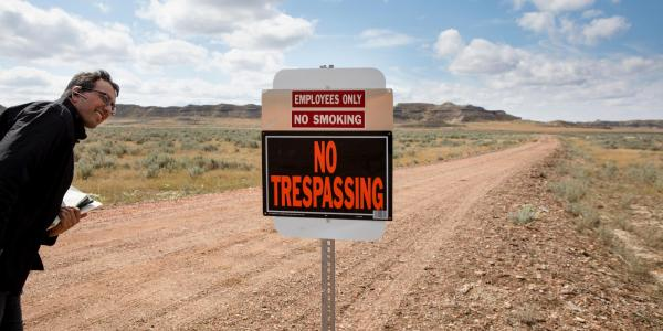 Eric Lipton looks at 'No Trespassing' sign