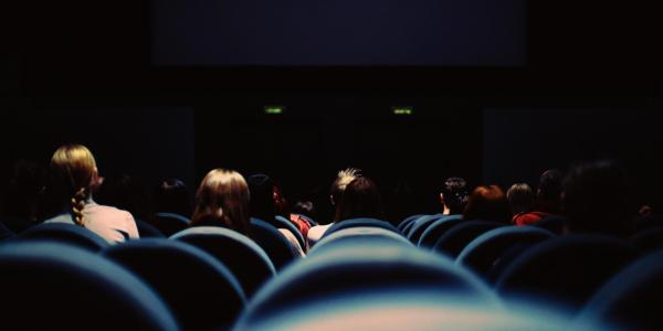People watch movie in theater