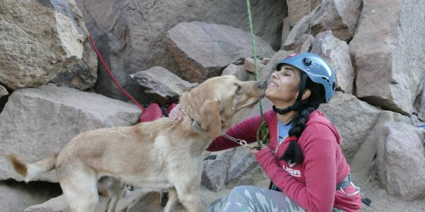 University of Colorado senior psychology major Esha Mehta gets some kisses from her seeing eye dog, Dragon, after rock climbing in Eldorado Canyon near Boulder. Mehta is a blind competitive rock climber.