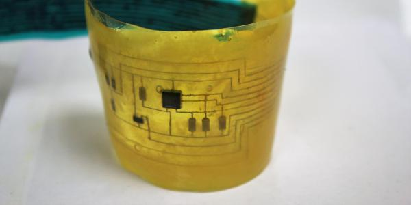 """An """"electronic skin"""" device bends in a curve."""