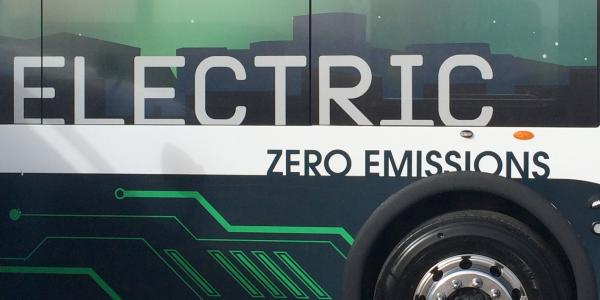 The side of an electric bus.