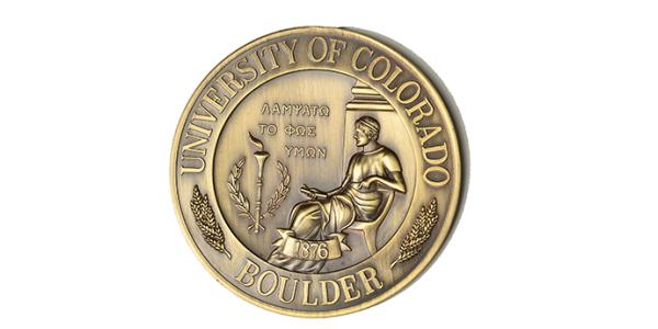 The bronze faculty medal, reflecting the seal of the university