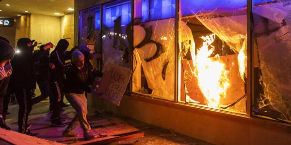 Protesters smash the window of a Chase bank during protests in Oakland