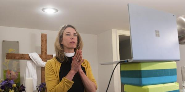 A pastor conducts online services from the basement of her home