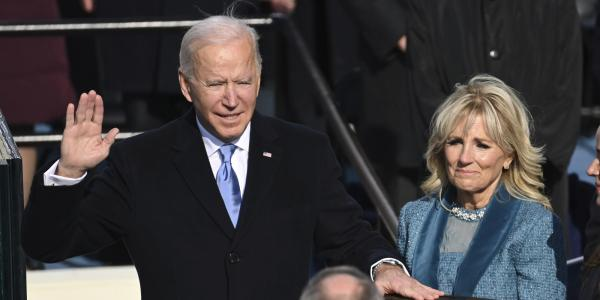 Jill Biden holds the Bible as Joe Biden is sworn in as the 46th president of the United States